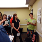 Round-robin critique at June 8th meeting: Reduce Food Waste group. Kelli Fox, design lead (center) and Connie DeMillo (design team)