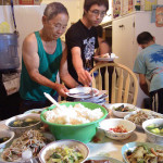 A home visit: A Hmong family that regularly uses the CAPI food shelf invited Sieng Lee—one of the design team members—to share one of their meals.